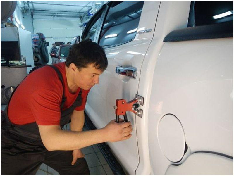 Ремонт вмятин без покраски с прикреплением к кузову дополнительных элементов