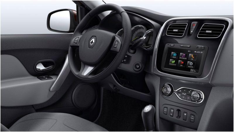 На фото Renault Logan 2015 года - руль и приборная панель
